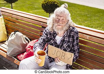 Cheerless jobless man having financial problems