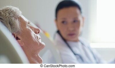 Cheerless sick aged man listening to his professional doctor