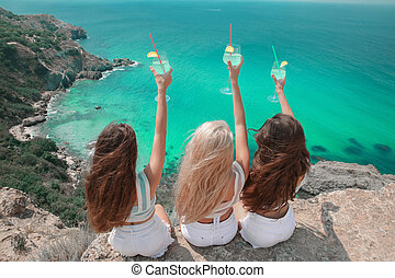 Cheers! Back view of Beautiful traveller girl friends having...