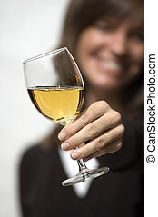 Black and white female model on white background raising a wine glass