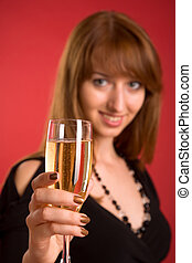 Cheers! Girl with champagne, focus on glass