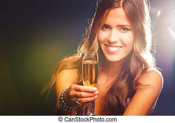smiling young woman celebrating with champagne
