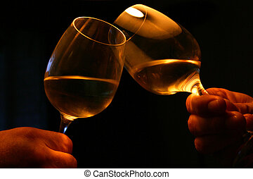 Two glasses toasting with dark background. Special atmosphere