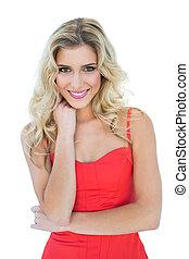 Cheery smiling blonde model looking at camera