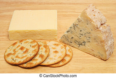 Cheese and biscuits on a board
