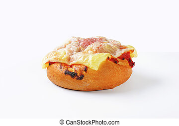 Cheese and ham topped bread bun