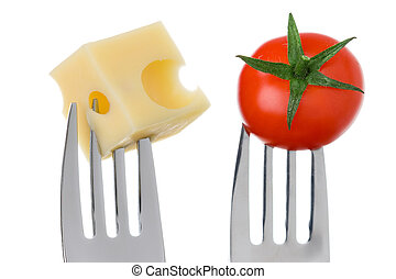 emmental cheese cube and cherry tomato on forks against white background