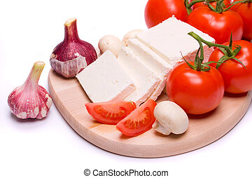 Cheese and tomato on white background - Cheese and tomato...