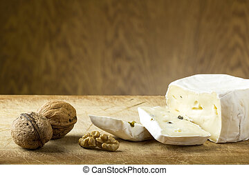 Cheese and walnuts - Close-up of cheese and walnuts on wood ...