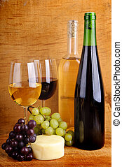 cheese and wine - still life with cheese, grapes, red and...