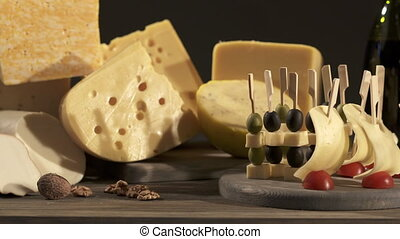 Cheese and wine tasting. Different types of cheese wedges,...