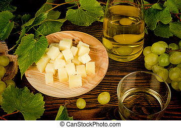 Cheese appetizer - Diced cheese served with grapes and white...