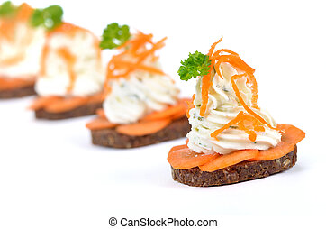 Cheese appetizers: Spiced cream cheese with carrot slices on...