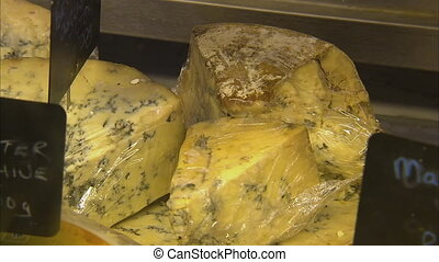 Cheese being sold in the market - A steady close up shot of...