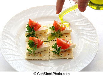 Cheese biscuits with tomatoes and oil