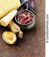 cheese board plate with plums jam