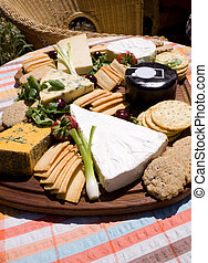 Cheese board with crackers fuit and salad in the summer...