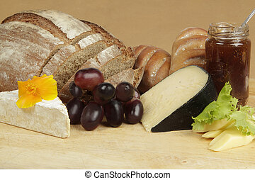 Cheese board with rye bread and fruit