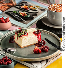 cheese cake with berries on the table