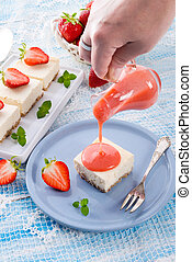 Cheese cake with strawberry sauce