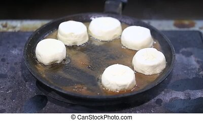 cheese cakes fried in a pan