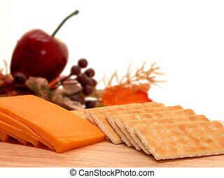 Cheese & Crackers 2 - A wooden tray of cheddar cheese and...
