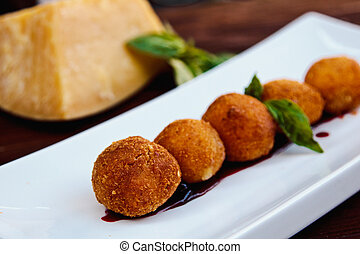Cheese croquettes (Cheese breaded Camembert with berry...