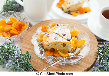 Cheese gratin closeup with dried apricot and raisins