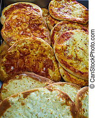 Cheese Manakish - Flat bread topped with cheese. Traditional Arab cuisine