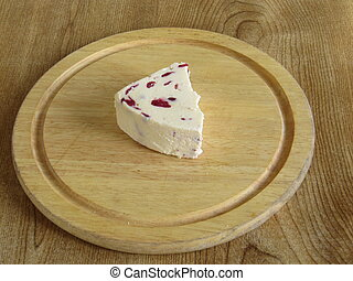 Cheese on a breadboard - Wensleydale cheese with cranberries...