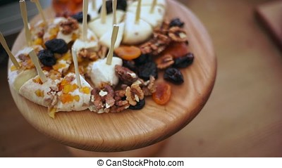 Cheese plate Assortment of various types of cheese on wooden...