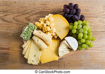 Cheese plate variation on a wooden table