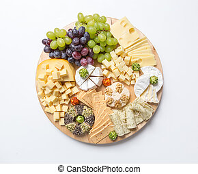 Cheese plate variation on white background.
