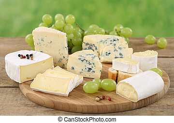 Cheese plate with Camembert, soft cheese and Brie on a...
