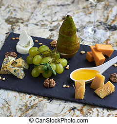 Cheese plate with fresh fruits