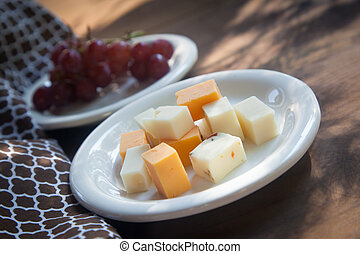 Cheese Plate with Red Seedless Grapes`