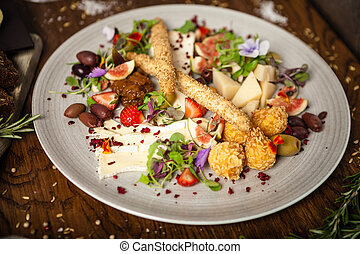 Cheese platter for two: Goat cheese cream, gorgonzola, ...