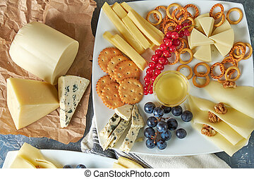 cheese platter on a plate with berries