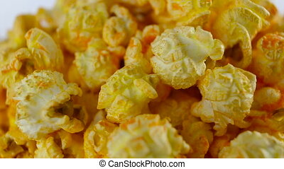Cheese popcorn in box on white background, rotation, very...