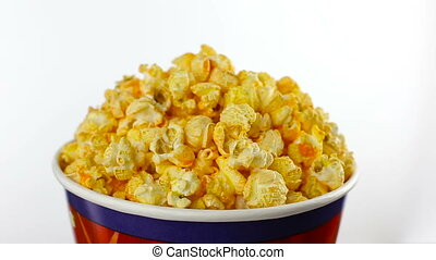 Cheese popcorn in box on white background, rotation close up...