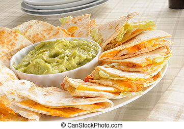 Cheese quesadilla - A plate of cheese quesadillas with ...