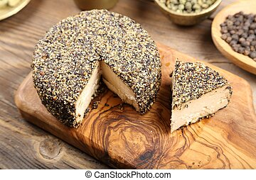 Cheese. - Ripened goat cheese with grains of black pepper.