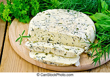 Cheese round homemade with herbs chopped