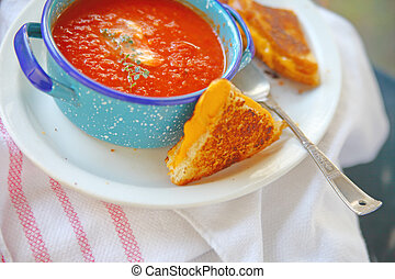 Cheese sandwich with tomato soup