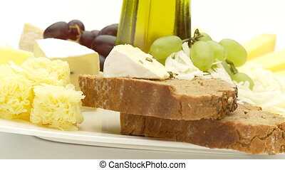 cheese selection, loop - different cheese with bread, grapes...