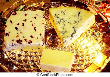 Cheese selection on glass plate. - Blue Stilton, Wensleydale...