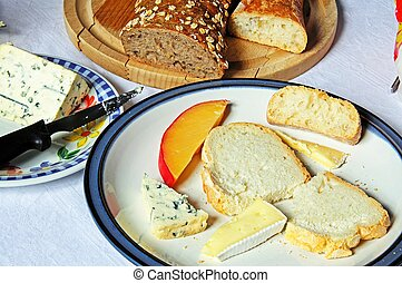 Cheese selection with bread. - Edam, Brie and Bleu D'...