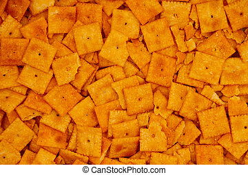 Cheese square crackers in pile background