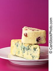 Cheese - Two pieces of fresh cheese blue stilton and...