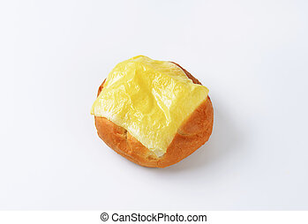 Bread bun with melted cheese on top